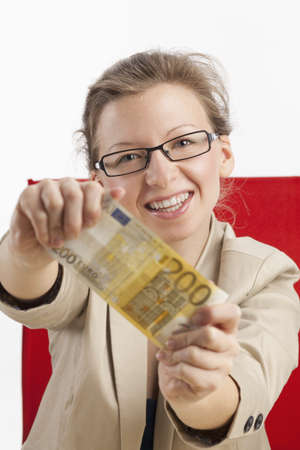 Young woman is happy about hundred euros photo