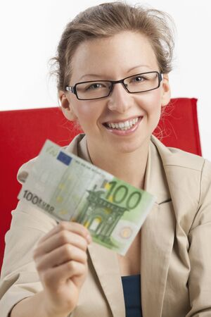 Young happy woman shows green euro note photo