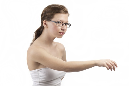 Young woman with an outstretched arm reaches out for something photo