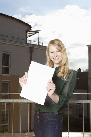 lodger: Young woman on the balcony showing sheet with space for text