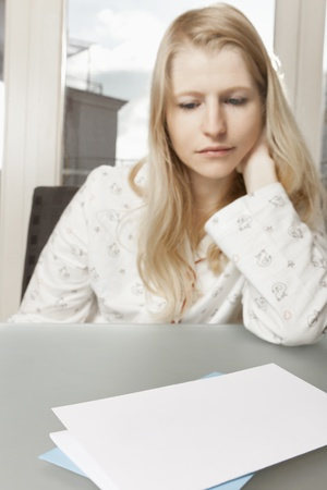 Woman looking sad on letter with space for text Stock Photo - 16661525