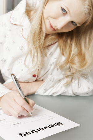 lodger: Woman in pajamas completes rental agreement Stock Photo