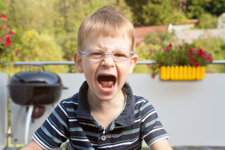 griller: Crying boy on terrace