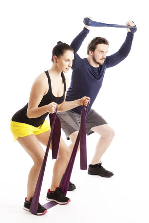 Two athletes doing their exercises with Theraband photo