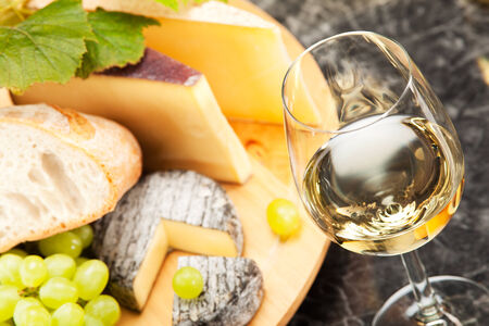 White wine with cheese platter grapes and white bread