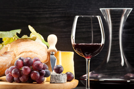 cheese plate: Red wine with wine grapes cheese plate and bread