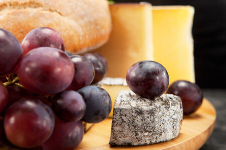 cheese plate: Cheese plate with red wine grapes and white bread