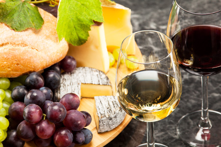 Gourmet food, cheese plate with grapes and bread to wine photo