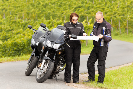 Two motorcyclists studying the Road map photo