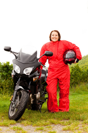 Motorcycle rider puts on rain protection
