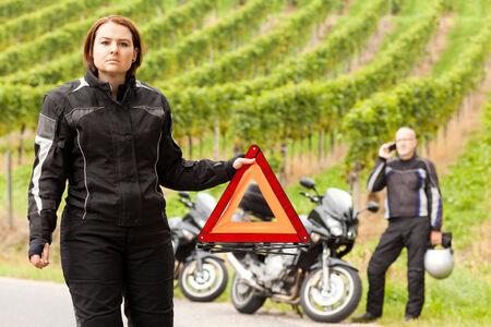 Motorcyclist with warning triangle Stok Fotoğraf
