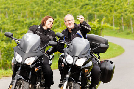 Two motorcyclists taking a Selfie photo