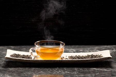 gunpowder tea: Gunpowder green tea in glass teapot