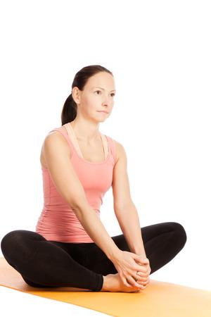 baddha: Yoga exercises in front of white background Stock Photo