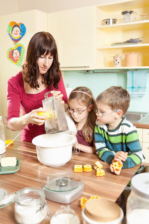 eagerly: Young family baking in the kitchen Stock Photo