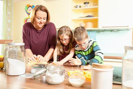 Mother baking cookies with her children Stok Fotoğraf