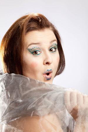 clowngesicht: Erstaunt Blick einer Frau mit Clown-Gesicht