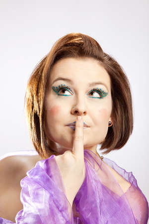 mouth cloth: Woman with finger on lips looks up thoughtfully