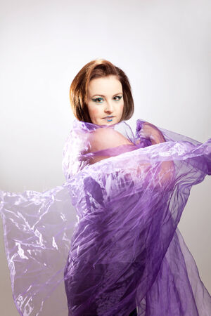 dynamically: Woman with make-up swings dynamically a cloth