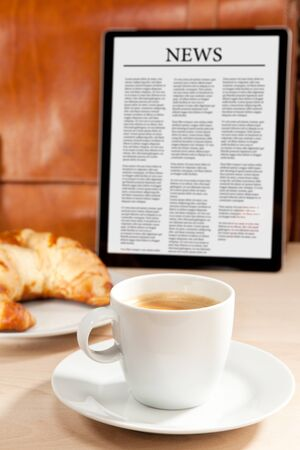 information age: Caffeine and news for breakfast Stock Photo