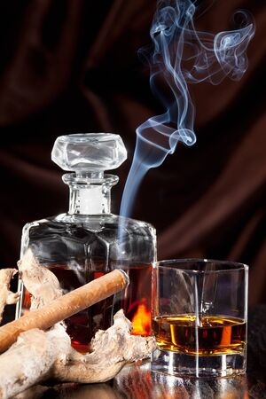 addictive drinking: Smoking cigar and whiskey in glass Stock Photo
