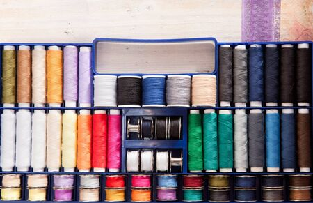 threadlike: Many colorful threads on a wooden box