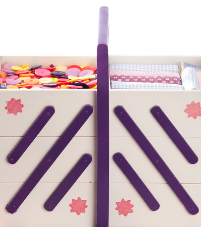 sewing box: Buttons and textile fabrics in a beautifully designed sewing box Stock Photo