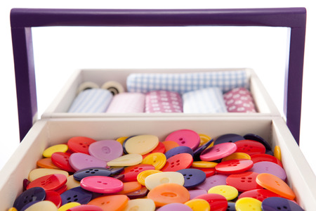 sewing box: Buttons and textile fabrics in a sewing box