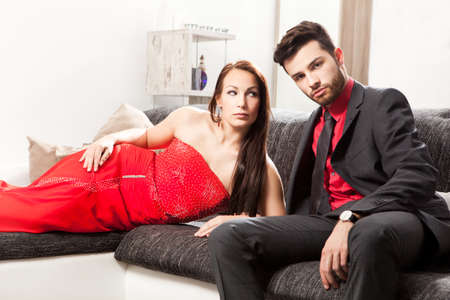couple on couch: Stylish young couple on a couch