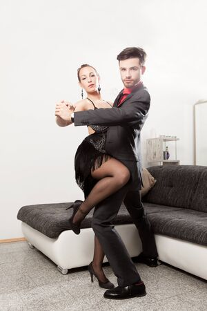 common room: Elegant young couple dancing at home