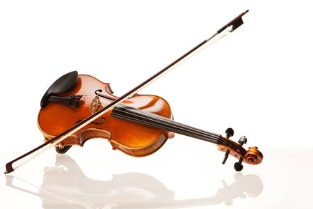 violin background: Violin with bow in front of white background Stock Photo