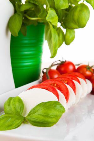 deliberately: Mozzarella salad with fresh basil, tomatoes and olive oil Stock Photo
