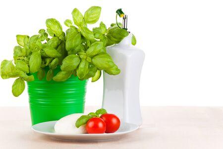 Mozzarella met tomaten, basilicum en olijfolie