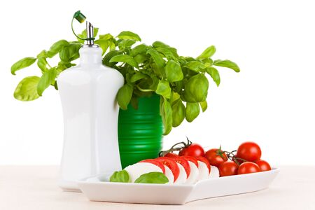 deliberately: Mozzarella salad with fresh basil, tomatoes and olive oil Stock Photo