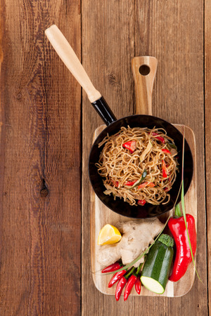Rustic noodle snack in the pan with fresh vegetables photo