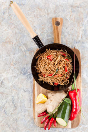 pan asian: Asian noodle snack in the pan with fresh ingredients