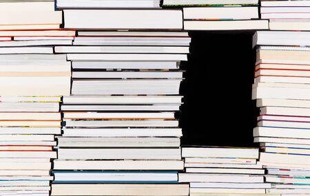 Black gap in a pile of books Stok Fotoğraf