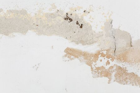 crumbling: Wall with crack and crumbling plaster