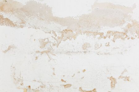 crumbling: White wall with crumbling plaster