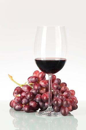 redwine: Red grapes and wine in glass Stock Photo