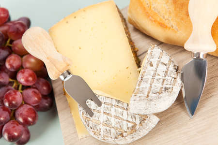 cheese platter: Cheese platter with grapes and baguette