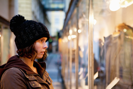business skeptical: Woman with thoughtful look to the shop window