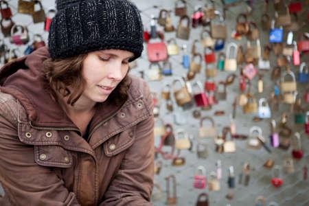 heartache: Woman with heartache on a lovers bridge