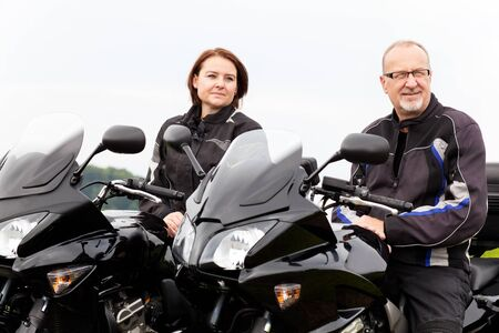 joyride: Woman and man on the motorcycle during a break Stock Photo