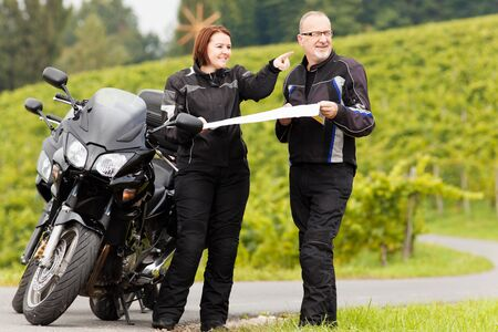 joyride: Two motorcyclists with road map