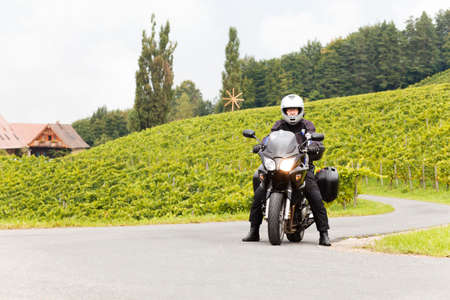 forked road: Biker stands at a crossroad