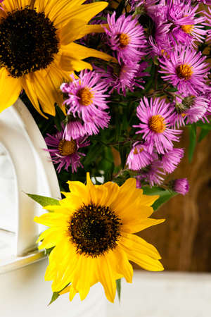 countryside loving: Sunflowers and asters in a watering can