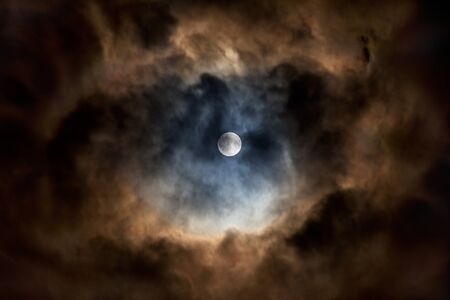 Full moon with spectacularly lit clouds all around Stok Fotoğraf