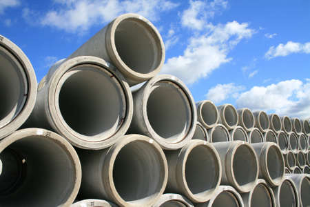 water pipes: Concrete water pipes stacked in rows Stock Photo