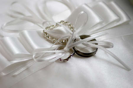 Two wedding ring on a ring cushion with bows very pretty  photo